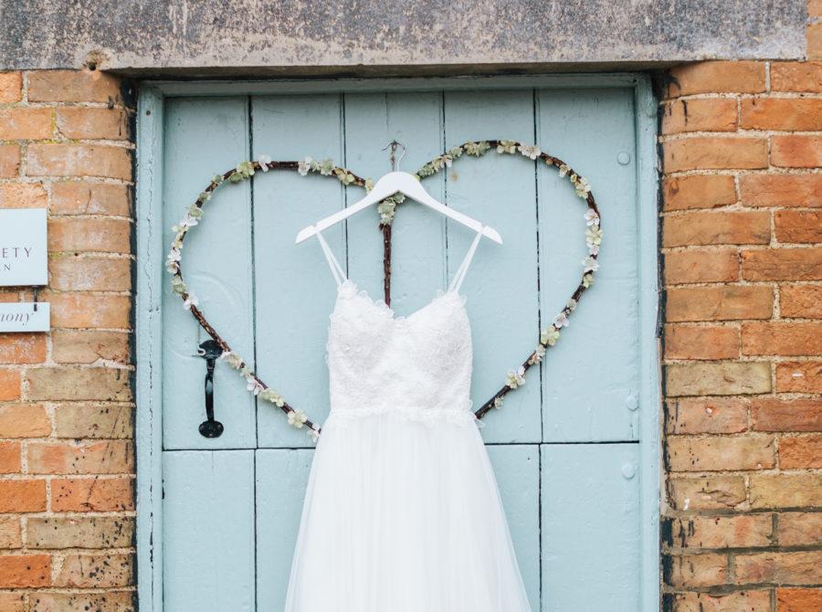 nea dress on rickety barn door